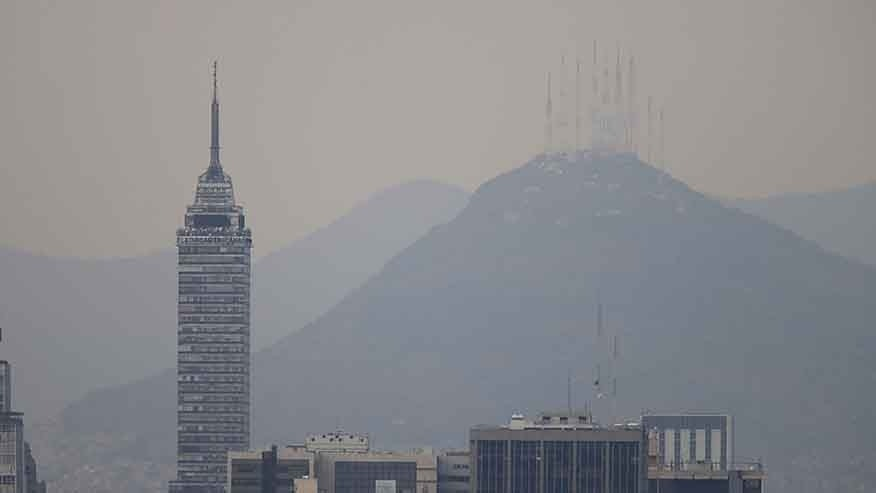 Buildings stand shrouded in smog in Mexico City, March 14, 2016.