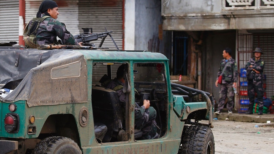 Police patrol the streets of Marawi city as government troops battle with Muslim militants who continue to hold their ground in some areas of the city for almost a week Monday, May 29, 2017 in southern Philippines.