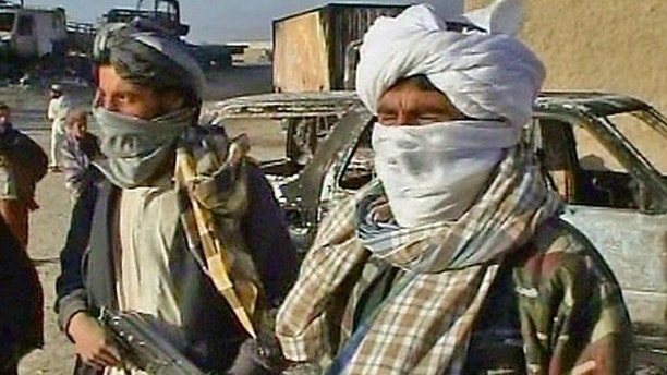 Oct. 20, 2009: Taliban militants are shown after they attacked a military convoy near Kabul, Afghanistan.