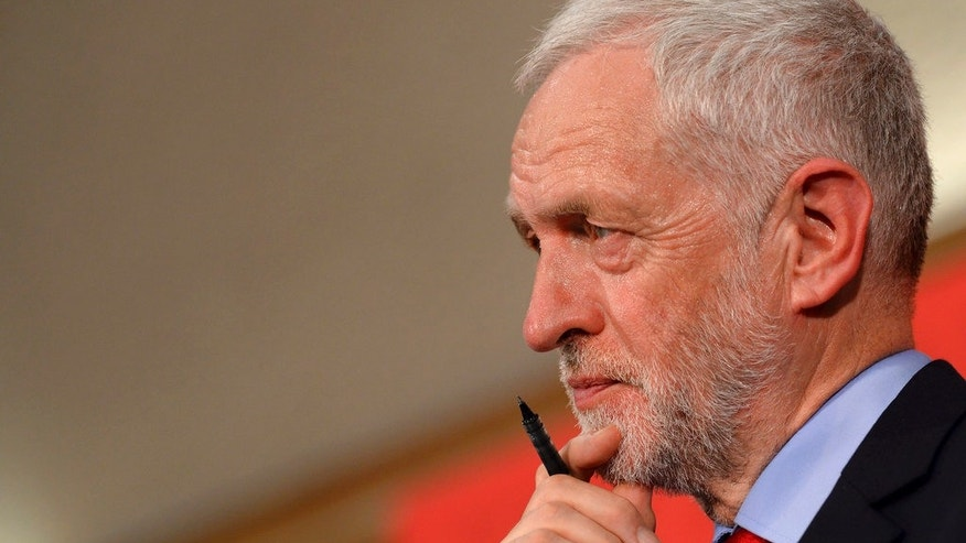 Britain's Labour Party Jeremy Corbyn called for Prime Minister Theresa May's resignation on Monday over previous police cuts while she was serving as home secretary. (Associated Press)