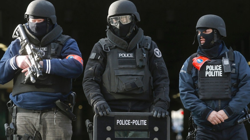 Belgian authorities have detained 12 people for interrogation following raids on Tuesday, June 6, 2017, that are connected to the 2016 terror attacks in Brussels.