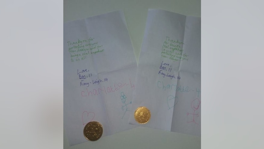 The notes for Manchester police came with chocolate coins.