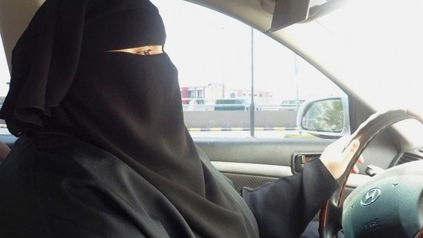 Umm Ibrahim sits behind the wheel of her vehicle as she drives in Riyadh, an act that is banned in Saudi Arabia June 21, 2011. To match feature SAUDI-WOMEN/DRIVING  REUTERS/Amena Bakr (SAUDI ARABIA - Tags: SOCIETY) BEST QUALITY AVAILABLE - RTR2NYH3