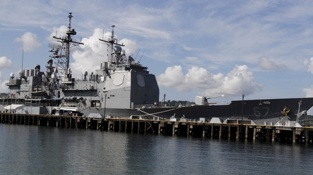 The USS Shiloh (CG-67), a U.S. Navy guided-missile cruiser, is docked at a port along Subic Bay, Zambales province, north of Manila, Philippines May 30, 2015. USS Shiloh (CG-67) arrived in the country on Friday to replenish supplies and strengthen ties with the Philippines through outreach programs as part of routine port call, the U.S. embassy in Manila said in a statement. REUTERS/Lorgina Minguito