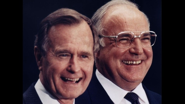 FILE PHOTO MAY89 - Helmut Kohl (R) is all smiles with former US President George Bush (L) in this May 30 1989 file photo, during Bush's visit to Germany. Around 60.5 million eligible Germans are called to vote for a new parliament in the general election on Sunday September 27.