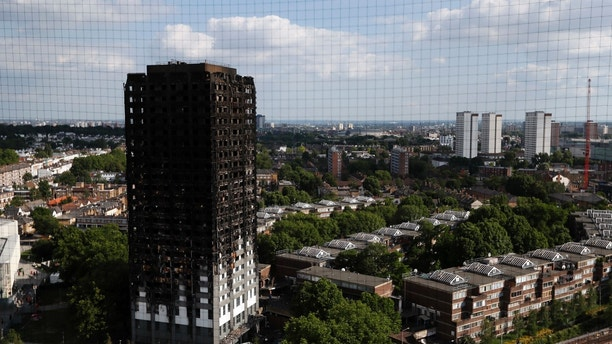 The remains of Grenfell Tower stand in London, Saturday, June 17, 2017. Police Commander Stuart Cundy said Saturday it will take weeks or longer to recover and identify all the dead in the public housing block that was devastated by a fire early Wednesday. (AP Photo/Kirsty Wigglesworth)