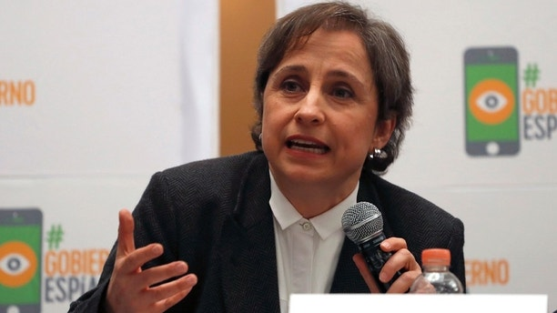 Mexican journalist Carmen Aristegui speaks during a press conference in Mexico City, Monday, June 19, 2017. An internet watchdog has found that Mexican journalists, lawyers and activists were targeted by Israeli-produced spyware that is sold exclusively to governments. Aristegui, who exposed a case of possible conflict of interest involving a luxury home acquired from a government contractor by President Enrique Pena Nieto's wife, was aggressively targeted according to Citizen Lab. (AP Photo/Eduardo Verdugo)