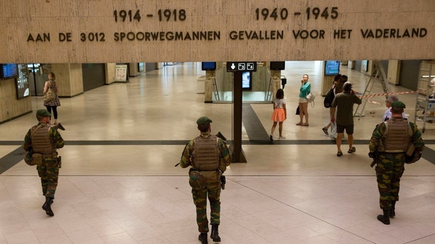 "Belgian Army soldiers patrol inside Central Station in Brussels on Wednesday, June 21, 2017. Belgian authorities said they foiled a ""terror attack"" when soldiers shot a suspect in the heart of Brussels after a small explosion at a busy train station Tuesday on a night that continued a week of attacks in the capitals of Europe. (AP Photo/Virginia Mayo)"