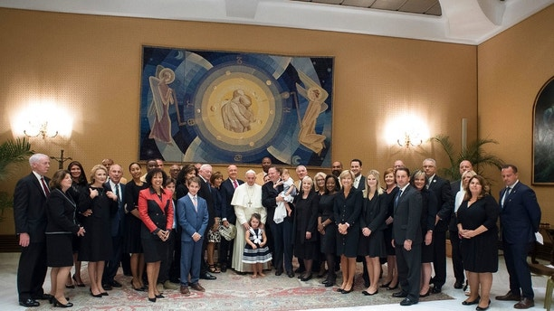 Pope Francis poses for a family picture with an NFL Hall of Fame delegation during a private audience at the Vatican, Wednesday, June 21, 2017. (L'Osservatore Romano/Pool Photo via AP)