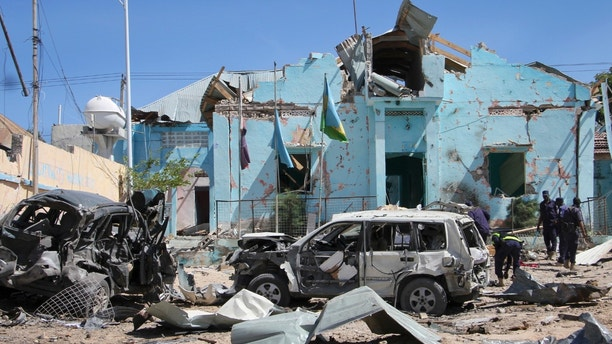 Somali security forces attend the scene of a car bomb attack in Mogadishu, Somalia Tuesday, June 20, 2017. A number of people are dead after a suicide car bomber in a vehicle posing as a milk delivery van detonated at a district headquarters in Somalia's capital, police said Tuesday. (AP Photo/Farah Abdi Warsameh)