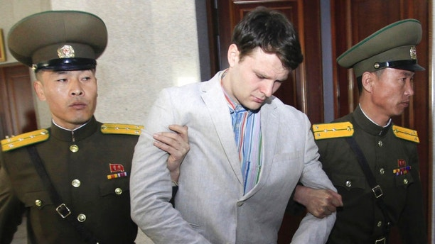 American student Otto Warmbier center is escorted at the Supreme Court in Pyongyang North Korea. Warmbier whose parents say has been in a coma while serving a 15-year prison term in North Korea was released