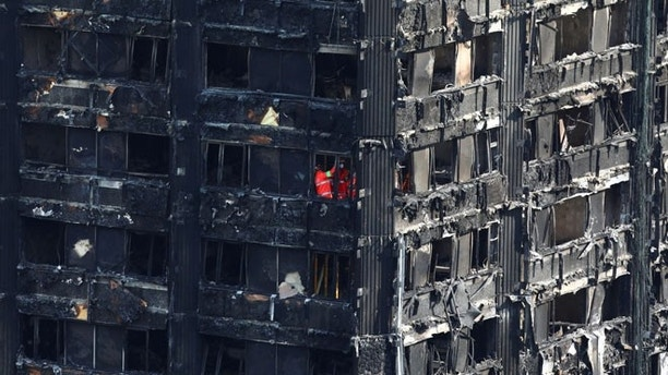 Members Of The Emergency Services Work Inside Burnt Out Remains Of The  Grenfell Apartment Tower In