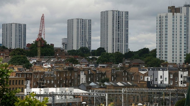 A general view of the housing towers of the Chalcots Estate in the borough of Camden, north London, Saturday June 24, 2017. Camden Borough Council said in a statement Saturday that it housed many of the residents at two temporary shelters while many others were provided hotel rooms, after inspectors found fire safety issues in housing towers, following the inferno in a west London apartment block that killed 79. (AP Photo/Alastair Grant)