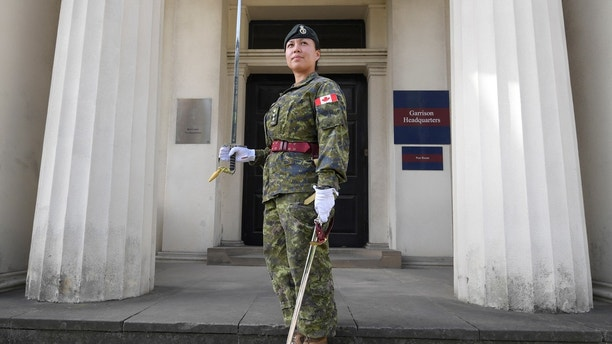 Captain Megan Couto of the 2nd Battalion, Princess Patricia's Canadian Light Infantry, poses for a photograph at Wellington Barracks, in central London, Britain June 26, 2017. Couto will make history today when she commands the Queen's Guard, during the Changing of the Guard ceremony, at Buckingham Palace, and becomes the first female officer to do so.   REUTERS/Toby Melville - RTS18MYR