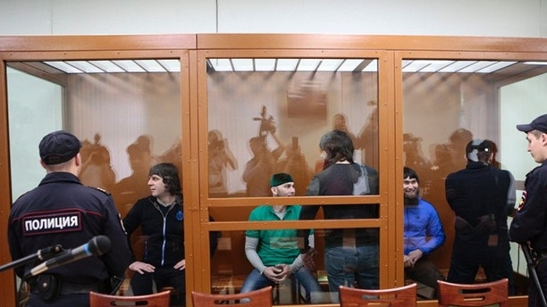 From left: Temirlan Eskerkhanov, Shadid Gubashev, Khamzat Bakhayev, Anzor Gubashev and Zaur Dadayev defendants suspected of involvement in the killing of opposition leader Boris Nemtsov, stand in a glass enclosure during their trial in a Moscow military district court in Moscow, Russia, Tuesday, June 27, 2017. A jury is expected to deliver its verdict in the trial of the  five Chechens charged in connection with the murder of opposition leader Boris Nemtsov who was shot dead on February 27, 2015. (AP Photo/Denis Tyrin)
