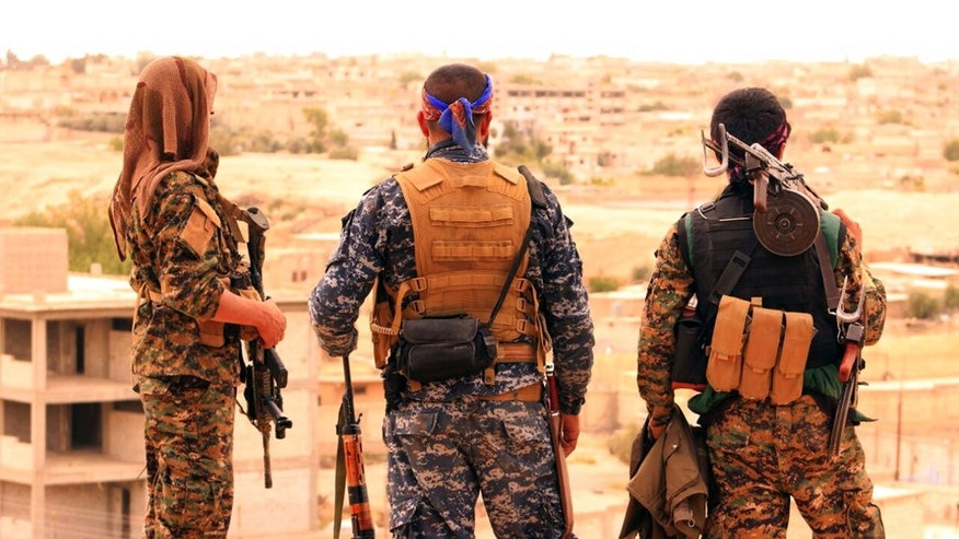 Syrian Democratic Forces looking toward the northern town of Tabqa, Syria.