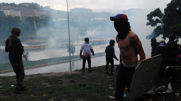 Riot in the main highway of Caracas after a demonstration against Nicolas Maduro