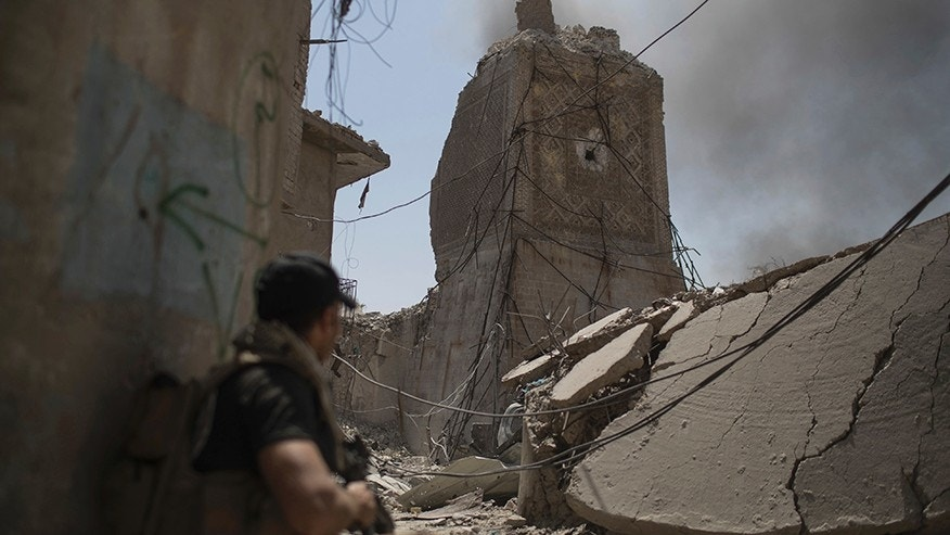 An Iraqi Special Forces soldier takes position near the destroyed al-Hadba minaret as they fight Islamic State militants in the Old City of Mosul, Iraq, Friday, June 30, 2017. (AP Photo/Felipe Dana)