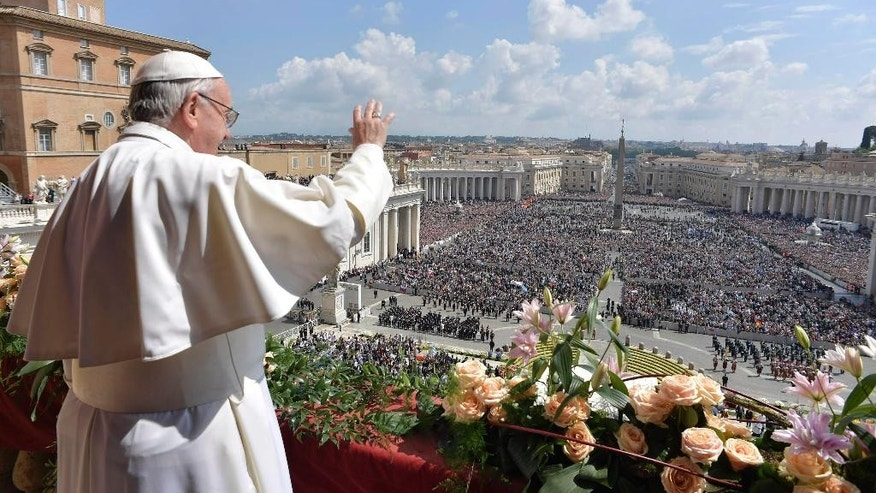 Pope Francis delivers a message from a main balcony of St. Peter's Basilica.