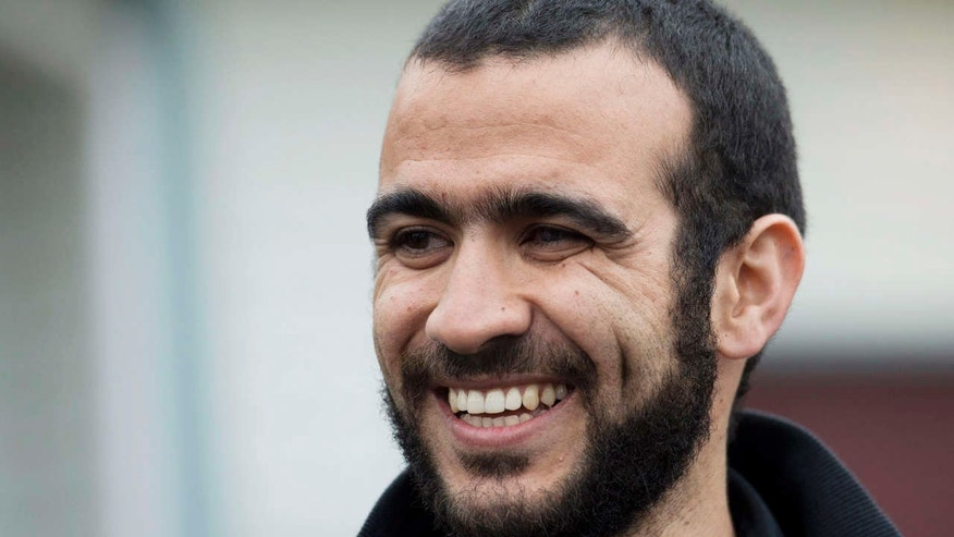 FILE - In this May 7, 2015 file photo, Omar Khadr speaks to the media outside his lawyer Dennis Edney's home in Edmonton, Alberta.