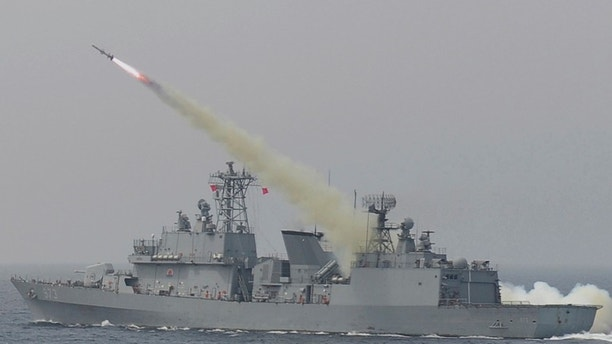 In this photo provided by South Korea Defense Ministry, a South Korean navy ship fires a missile during a drill in South Korea's East Sea, Thursday, July 6, 2017. South Korean warplanes and navy ships have fired a barrage of missiles into the waters during one-day drills aimed at boosting a readiness against a possible North Korean aggression. (South Korea Defense Ministry via AP)