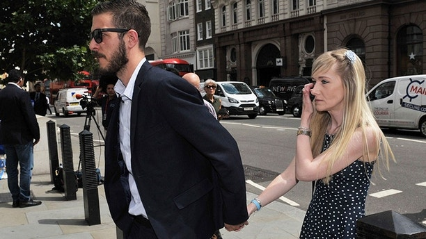 The parents of sick child Charlie Gard, Connie Yates and Chris Gard as they arrive at the High Court in London for a hearing in their latest bid to see him treated with an experimental therapy, in London Monday July 10, 2017. Charlie Gard is on life support at Great Ormond Street Hospital, and remains at the centre of a legal battle to allow the terminally ill infant to receive experimental treatment for his rare genetic disease, mitochondrial depletion syndrome. (Nick Ansell(/PA via AP)