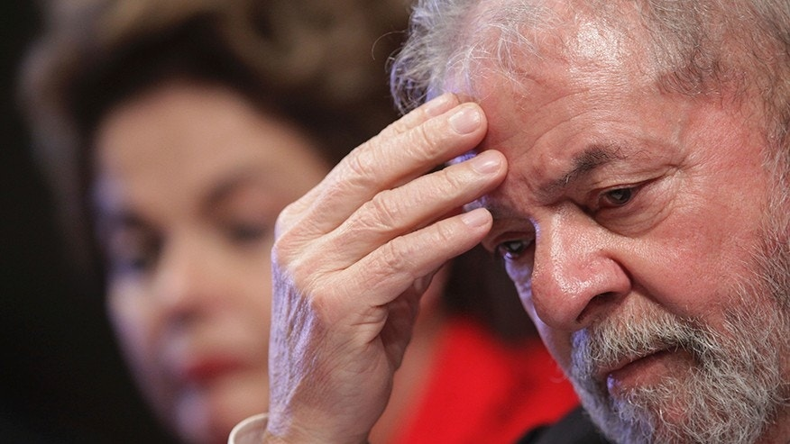 Former Brazil leader Lula sentenced to jail for graft