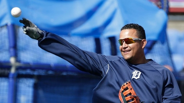 Detroit Tigers first baseman Miguel Cabrera (24) throws to warm up before taking batting practice prior to a spring training baseball game iagainst the Toronto Blue Jays in Dunedin, Fla., Saturday, March 22, 2014. (AP Photo/Kathy Willens)