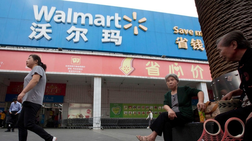 Residents walk past a Walmart in Shenzhen in southern China's Guangdong province in 2015
