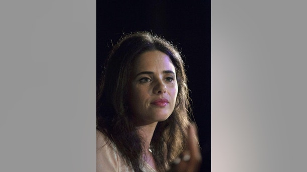 "FILE - In this file photo taken Feb. 24, 2015, Ayelet Shaked of Jewish Home party listens during a debate hosted by the Israel Women's Network in Tel Aviv. The most scrutinized appointment for the new Israeli government is that of the 39-year-old Shaked as justice minister, an influential post typically filled by a person with particular political or professional prestige. In 2014, she drew international attention for posting on Facebook a decade-old article written by a settler author that referred to Palestinian children as ""little snakes"" and appeared to justify the mass punishment of Palestinians living under Israeli occupation. (AP Photo/Tsafrir Abayov, File)"
