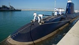 "FILE - In this Jan. 12, 2016 file photo, Israeli sailors stand on a German-built  ""Rahav"" submarine on its arrival in to the military port in Haifa, Israel. An Israeli spokesman said Wednesday, July 12, 2017, that David Shimron, a close confidante, personal attorney and cousin of Prime Minister Benjamin Netanyahu, was questioned by police over his involvement in the purchase of German submarines following revelations that he represented the German firm involved in the $1.5 billion deal, raising the prospect of a conflict of interests. (AP Photo/Ariel Schalit, File)"