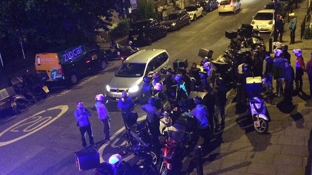 This is an image made available by Sarah Cobbold of  the scene of an acid attack in London early Thursday July 13, 2017. Police said that  five linked acid attacks by men on mopeds in London have left several people injured _ the latest in a spate of such crimes that have alarmed residents and politicians. The Metropolitan Police force says the 90-minute spree began late Thursday when Two men on a moped tossed a noxious substance into the face of a 32-year-old moped driver, then jumped on his vehicle and drove away. (Sarah Cobbold via AP)