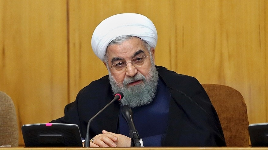 In this photo released by official website of the office of the Iranian Presidency, President Hassan Rouhani speaks during a cabinet meeting in Tehran, Iran, Wednesday, July 19, 2017. Iran's president said Wednesday that his country will stand up to the United States and reciprocate for any new sanctions that America imposes on the Islamic Republic. (Iranian Presidency via AP)