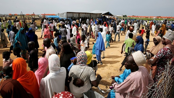 People gather at Bakassi camp, Borno, Nigeria July 18, 2017. REUTERS/Afolabi Sotunde - RTX3BZPY