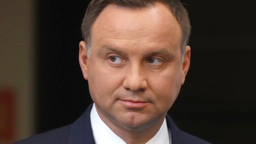 FILE: President Andrzej Duda looks on after his media announcement about Supreme Court legislation at Presidential Palace in Warsaw