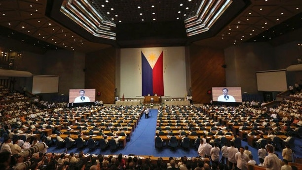 Philippine President Rodrigo Duterte delivers his speech during the second state of the nation address at the House of Representatives in suburban Quezon city, north of Manila, Philippines, Monday, July 24, 2017. Duterte said he will not stop his deadly crackdown on illegal drugs and warns that addicts and dealers have two choices: jail or hell. (AP Photo/Aaron Favila)