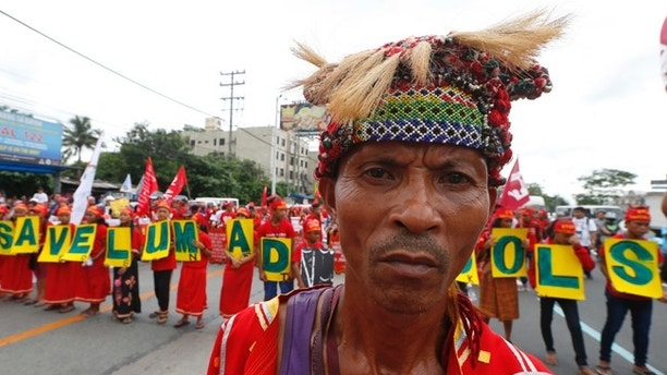 "In this Monday, July 24, 2017, photo, Indigenous people known as Lumads form the words ""Save Lumad Schools"" as they join a march of thousands of protesters to coincide with the state of the nation address of Philippine President Rodrigo Duterte in Quezon city northeast of Manila, Philippines. Human rights groups asked Duterte Wednesday, July 26, 2017, to retract a threat to order airstrikes against tribal schools he accused of teaching students to become communist rebels, warning such an attack would constitute a war crime. U.S.-based Human Rights Watch said international humanitarian law ""prohibits attacks on schools and other civilian structures unless they are being used for military purposes,"" adding that deliberate attacks on civilians, including students and teachers, ""is also a war crime."" (AP Photo/Bullit Marquez)"