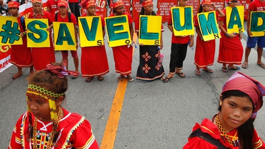 Young indigenous people known as Lumads march to coincide with Philippine President Rodrigo Duterte's state of the nation address.