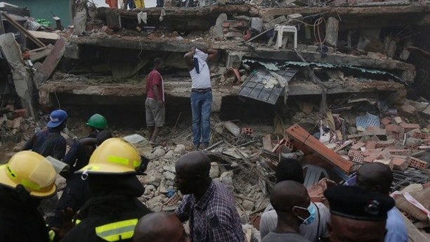 Rescue workers search for survivors at the rubbles of a collapsed building in a densely populated neighborhood in Lagos, Nigeria. Tuesday, July 25, 2017. Rescue work is still ongoing. (AP Photo/Sunday Alamba)