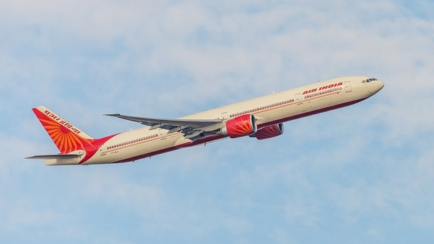 New York, NY, USA - November 2, 2013: Boeing 777 Air India takes off from John F. Kennedy International Airport in New York, NY on November 2, 2013. Air India is the flag carrier and the third largest airline in India.