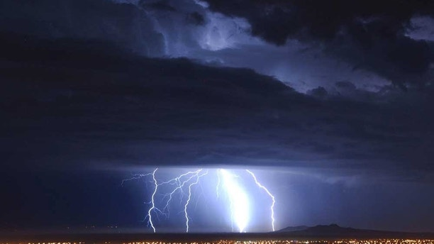 Lightning strikes over Palmdale, Calif., early Tuesday Oct. 19, 2010 as a low pressure system brings unsettled wet weather to Southern California. (AP Photo/Mike Meadows)
