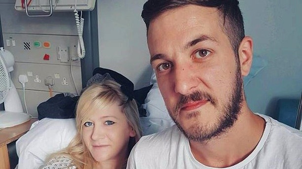 This is an undated hand out photo of Chris Gard and Connie Yates with their son Charlie Gard provided by the family, at Great Ormond Street Hospital, in London. The president of the United States has offered to help. The pope is willing to have the Vatican hospital take him in. Some 1.3 million pounds ($1.68 million) have been raised to help him leave Britain for treatment. But little has changed Tuesday July 4, 2017, for Charlie Gard, a terminally-ill British infant suffering from a rare genetic disease that has left him severely brain damaged. (Family of Charlie Gard via AP)