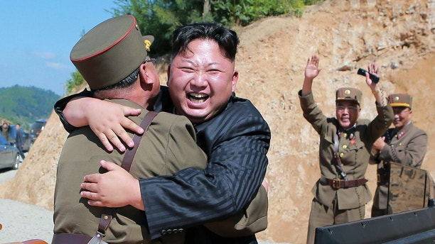 North Korean leader Kim Jong Un reacts with scientists and technicians of the DPRK Academy of Defence Science after the test-launch of the intercontinental ballistic missile Hwasong-14 in this undated photo released by North Korea's Korean Central News Agency (KCNA) in Pyongyang July, 5, 2017. KCNA/via REUTERS ATTENTION EDITORS - THIS IMAGE WAS PROVIDED BY A THIRD PARTY. REUTERS IS UNABLE TO INDEPENDENTLY VERIFY THIS IMAGE. NO THIRD PARTY SALES. SOUTH KOREA OUT.     TPX IMAGES OF THE DAY - RTX3A3DQ