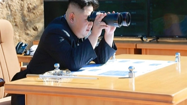 This image made from video of a news bulletin aired by North Korea's KRT on Tuesday, July 4, 2017, shows what was said to be North Korea leader Kim Jung Un, center, using binoculars to watch the launch of a Hwasong-14 intercontinental ballistic missile, ICBM, in North Korea's northwest. Independent journalists were not given access to cover the event depicted in this photo. North Korea claimed to have tested its first intercontinental ballistic missile in a launch Tuesday, a potential game-changing development in its push to militarily challenge Washington — but a declaration that conflicts with earlier South Korean and U.S. assessments that it had an intermediate range. (KRT via AP Video)