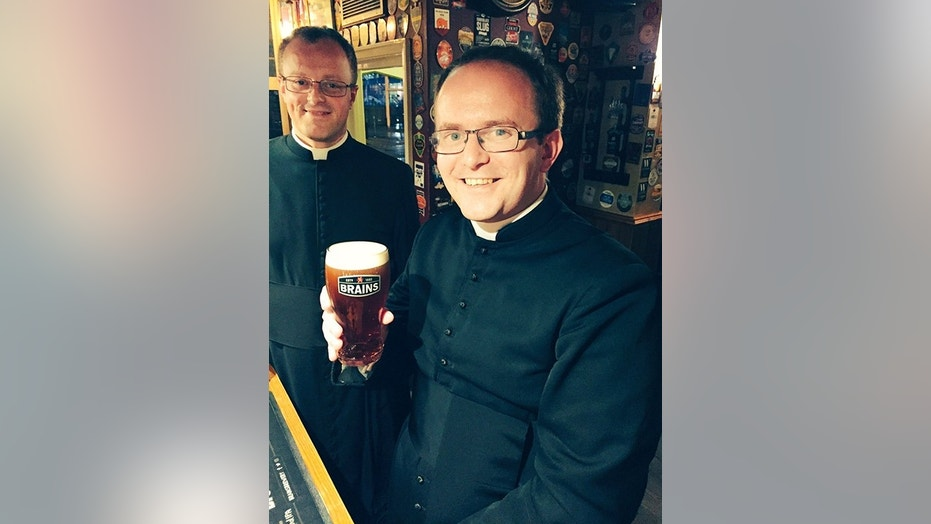 The Rev. Robert James enjoys a pint after Saturday's misunderstanding was sorted out.