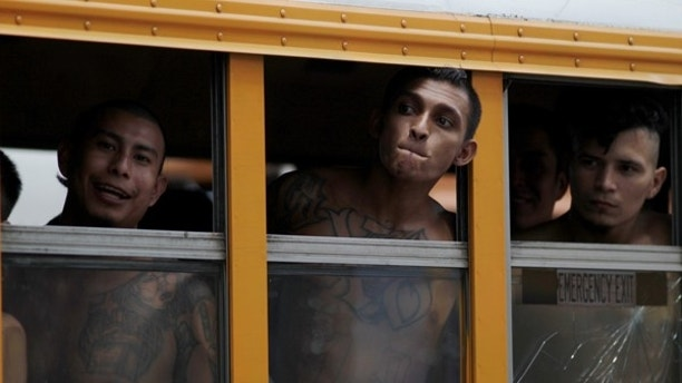 Members of the Barrio 18 Gang wait on a bus as 1282 inmates are transferred from the cojutepeque jail in Cojutepeque, El Salvador June 16, 2016. REUTERS/Jose Cabezas - RTX2GOBY