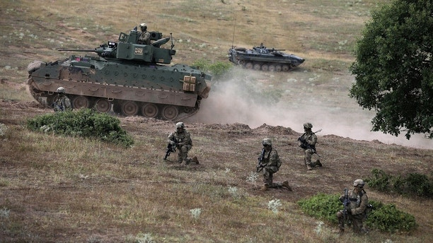"U.S. army soldiers take part in ""Peace Sentinel 2017"", a joint military drill together with Serbian and Bulgarian soldiers at Koren military training ground, Bulgaria, July 15, 2017.  REUTERS/Stoyan Nenov - RTX3BK1O"
