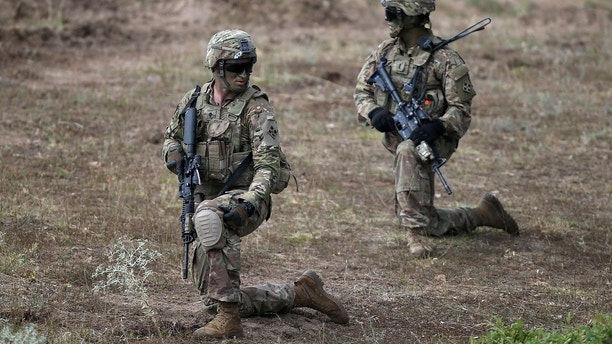 "U.S. army soldiers take part in ""Peace Sentinel 2017"", a joint military drill together with Serbian and Bulgarian soldiers, at Koren military training ground, Bulgaria, July 15, 2017.  REUTERS/Stoyan Nenov - RTX3BK1Q"