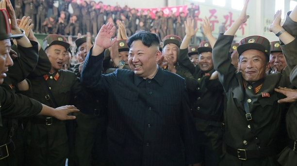 North Korean leader Kim Jong Un reacts with scientists and technicians of the DPRK Academy of Defence Science after the test-launch of the intercontinental ballistic missile Hwasong-14 in this undated photo released by North Korea's Korean Central News Agency (KCNA) in Pyongyang July 5, 2017. KCNA/via REUTERS ATTENTION EDITORS - THIS IMAGE WAS PROVIDED BY A THIRD PARTY. REUTERS IS UNABLE TO INDEPENDENTLY VERIFY THIS IMAGE. NO THIRD PARTY SALES. SOUTH KOREA OUT. - RTX3A3V0