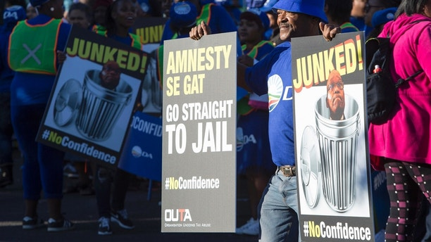 Protesters against President Jacob Zuma, march to parliament in Cape Town South Africa, Tuesday Aug. 8, 2017. South Africa's parliament is voting on a motion of no confidence in embattled President Jacob Zuma. If the motion succeeds, he must resign. The parliamentary speaker made the surprise decision to allow the vote to be conducted by secret ballot.  (AP Photo/Halden Krog)
